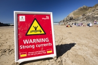 Cornwall;UK;coast;plant;St-Agnes;sea;cliff;sea-cliff;summer;sign;yellow;South-west;warm;cove;beach;Coast-guard;life-guard;vehicle;four-wheel-drive;surfing;surf-board;pebble;sand;Chapel-Porth;red;warning;currents;strong-currents;danger