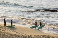 Cornwall;UK;coast;sky;sea;cloud;dusk;evening;sunset;water;beach;sand;Porthmeor;St-Ives;St-Ives-Head;wave;breaker;swell;light;surf;surfer;surfers;surf-board;group;friends;hanging-out;relax;hobby;sport;persuit