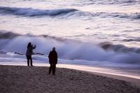Cornwall;UK;coast;sky;sea;cloud;dusk;evening;sunset;water;beach;sand;Porthmeor;St-Ives;St-Ives-Head;wave;breaker;swell;light;surf;sunset;glow;colour;movement;motion;blur;motion-blur;couple;two;romantic;photograph;digital;camera;picture