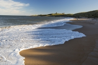Low-Newton-by-the-Sea;Northumberland;UK;coast;beach;sand;sandy;North-sea;high-tide;wave;sand-dunes;dunes;foam;white;Dunstanburgh-castle