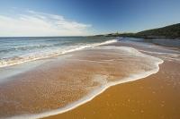Low-Newton-by-the-Sea;Northumberland;UK;coast;beach;sand;sandy;North-sea;high-tide;wave;sand-dunes;dunes;foam;white;Dunstanburgh-castle