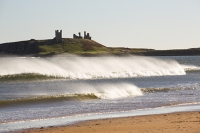 Low-Newton-by-the-Sea;Northumberland;UK;coast;beach;sand;sandy;North-sea;high-tide;wave;sand-dunes;dunes;foam;white;Dunstanburgh-castle;spary;wind;windy;blowing;white-water
