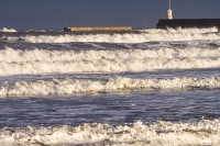Northumberland;UK;Seahouses;weather;wave;breaking;surf;light;sunlight;beach;harbour