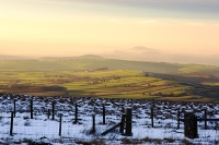 mountain;hill;weather;mist;misty;visibility;air-quality;high-pressure;winter;cold;snow;Hartside;vista;view;fence;Pennines;North-Pennines;Hartside;dusk;sunset;cloud;mountain-pass;contrast;snowpack;sunset;glow;warm;light;moorland;sedge;landscape;valley;eden-Valley;field;farming;green