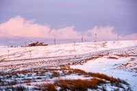 mountain;hill;weather;mist;misty;visibility;air-quality;high-pressure;winter;cold;snow;Hartside;vista;view;fence;Pennines;North-Pennines;Hartside;dusk;sunset;cloud;mountain-pass;cafe;building;Hartside-Cafe;contrast;snowpack;sunset;glow;warm;light;moorland;sedge;landscape;peat