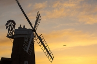 windmill;Cley-Next-the-Sea;North-Norfolk;UK;coast;wind-power;building;architecture;sail;house;sky;clear;dusk;evening;sunset;glow;orange;colourful;airplane;RAF;flight;flying
