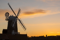 windmill;Cley-Next-the-Sea;North-Norfolk;UK;coast;wind-power;building;architecture;sail;house;sky;clear;dusk;evening;sunset;glow;orange;colourful;church;Blakeney
