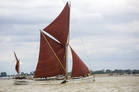 Brightlingsea;Essex;England;UK;coast;estuary;port;Thames;boat;ship;yacht;sailing-boat;Smack;Smack-ship;fishing-boat;local;history;heritage;fishing-boat;wooden;wooden-boat;sailing-boat;brown;cloth;sail;mast;boom;under-sail