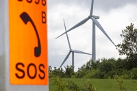 wind-farm;wind-farm;UK;renewable;renewable-energy;green;clean;carbon-neutral;energy;electricity;wind-turbine;climate-change;global-warming;onshore;movement;motion-blur;turning;generating;Cranford;rubbish;Northamptonshire;Yelvertoft;Yelvertoft-windfarm;orange;SOS;emergency-phone;telephone;layby