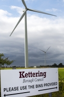 wind-farm;wind-farm;UK;renewable;renewable-energy;green;clean;carbon-neutral;energy;electricity;wind-turbine;climate-change;global-warming;onshore;movement;motion-blur;turning;generating;Cranford;rubbish;Northamptonshire;Yelvertoft;Yelvertoft-windfarm;layby;sign;Kettering;rubbish;litter;bin