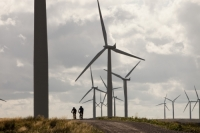 IMG_3703_p.jpg Mountain bikers at Black Law windfarm near Carluke in Scotland, UK. When it was constructed it was the largest wind farm in the UK with 54 turbines with a capacity of 97 Megawatts, enough to power 70,000 homes. The wind farm was built on the site of an old open cast coal mine.
